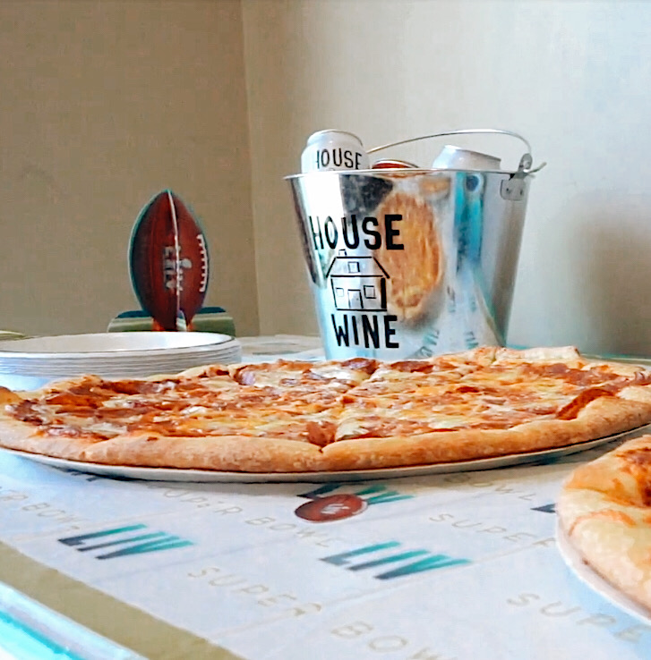 Pizza and House Wine ice buckets with wine cans