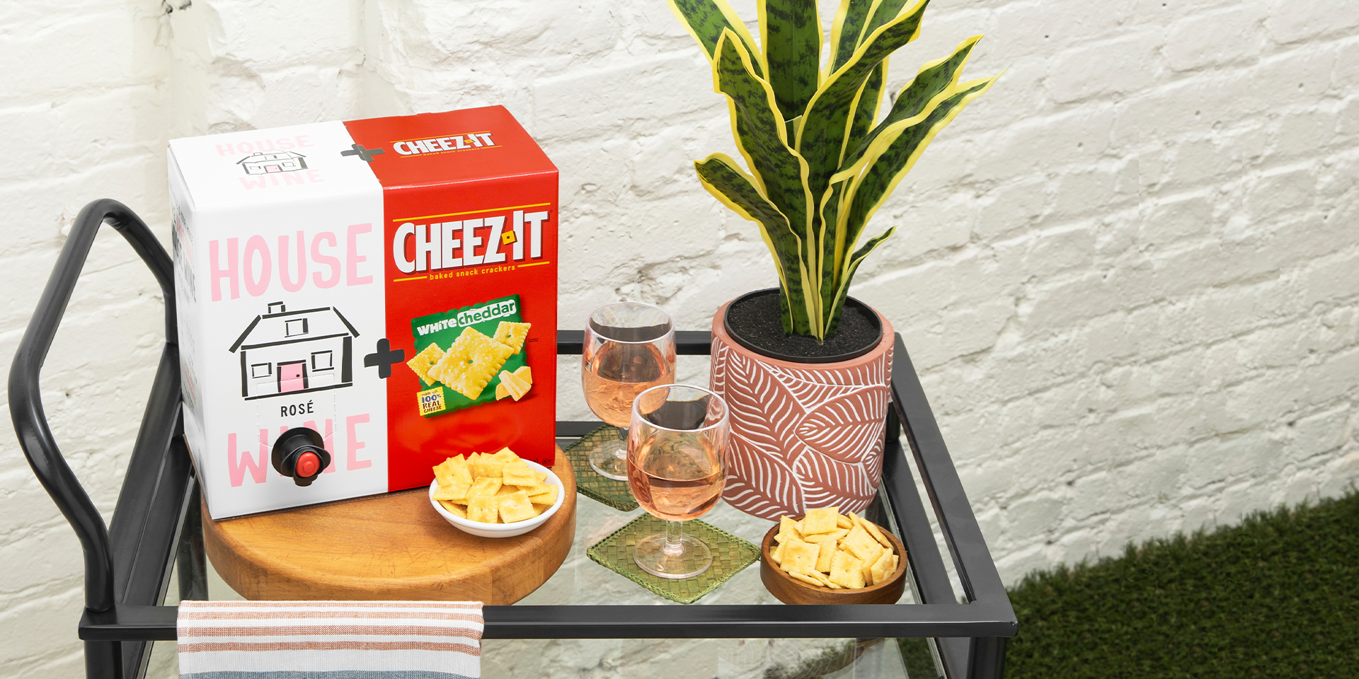House Wine Rose and Cheez-It White Cheddar Box on bar cart