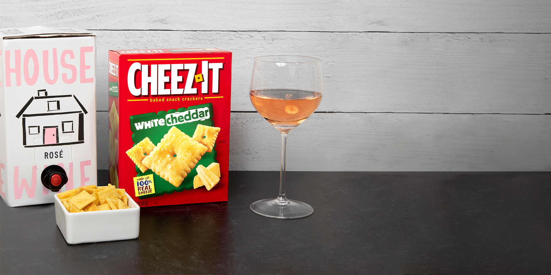 House Wine rosé box and Cheez-It white cheddar crackers on counter