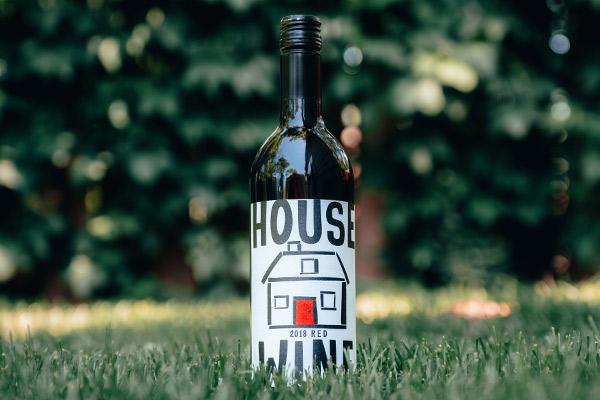 house wine original red blend bottle in grass